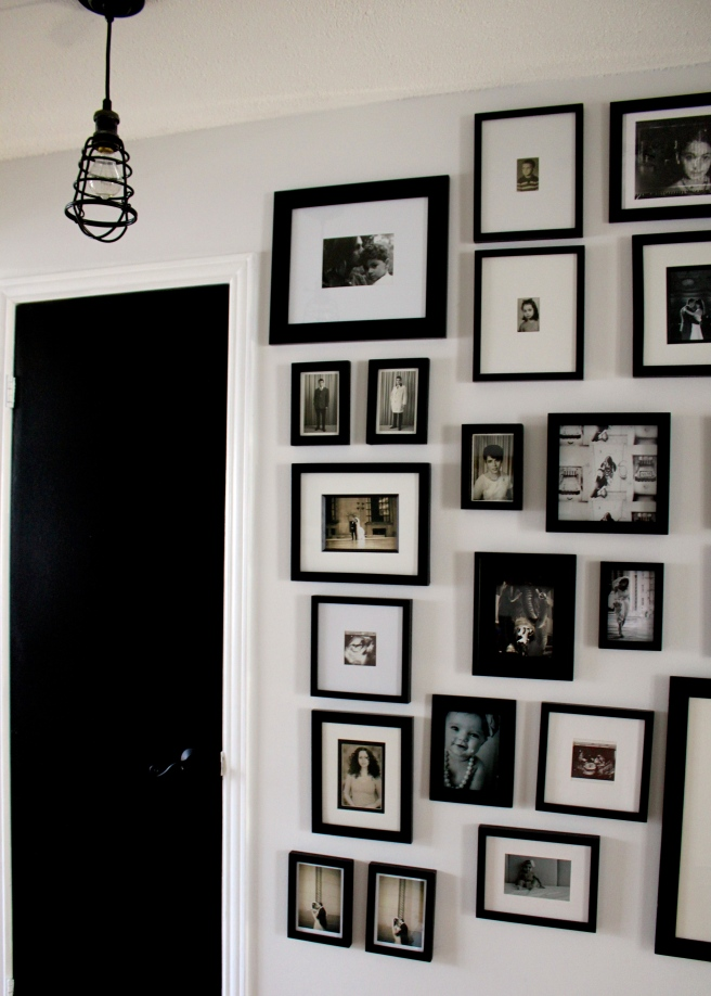 Black and white photo wall, painted black door and black light